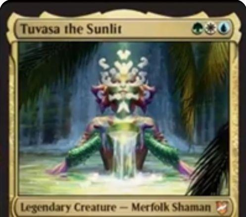 【統率者2018】バント色の伝説神話生物「Tuvasa the Sunlit」が公開!3マナ1/1のマーフォーク・シャーマンで、自軍エンチャントの数だけ+1/+1の修正を得る!各ターン最初のエンチャント呪文に反応してドローできる能力も!